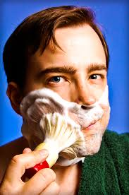 Foaming the face with shave brush wet shaving